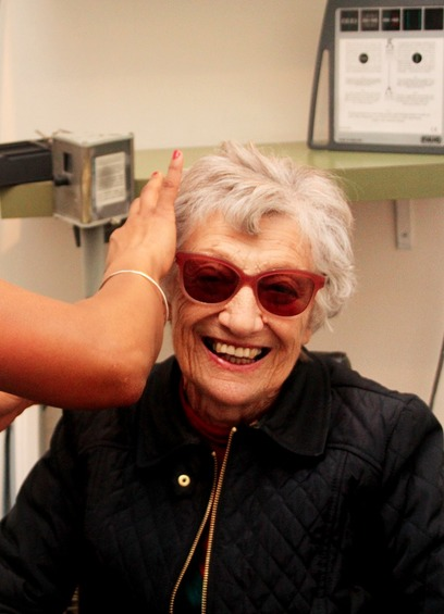Older woman being fitted with tinted glasses
